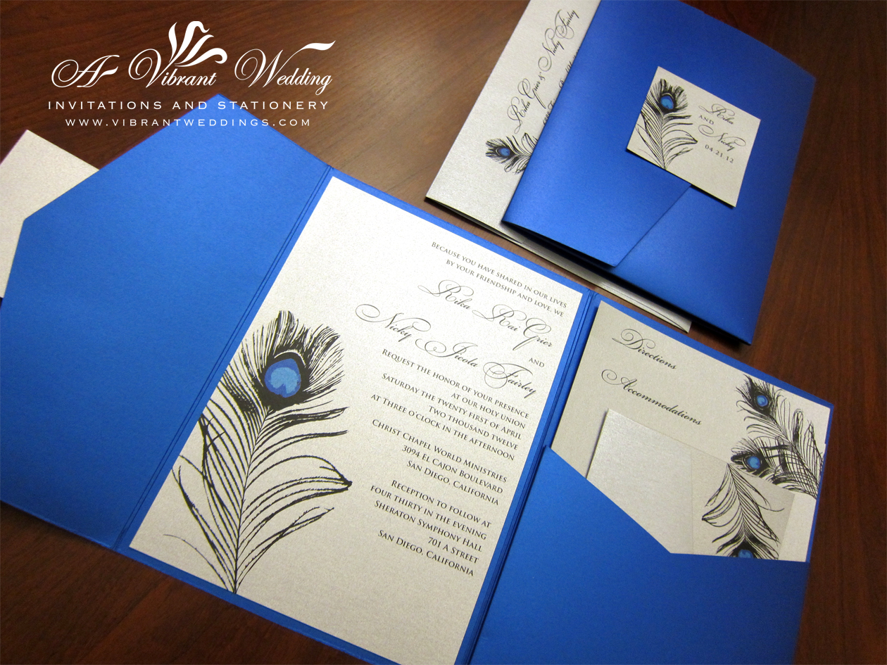 Royal Blue Platinum Wedding Invitation With Peacock Feather Design